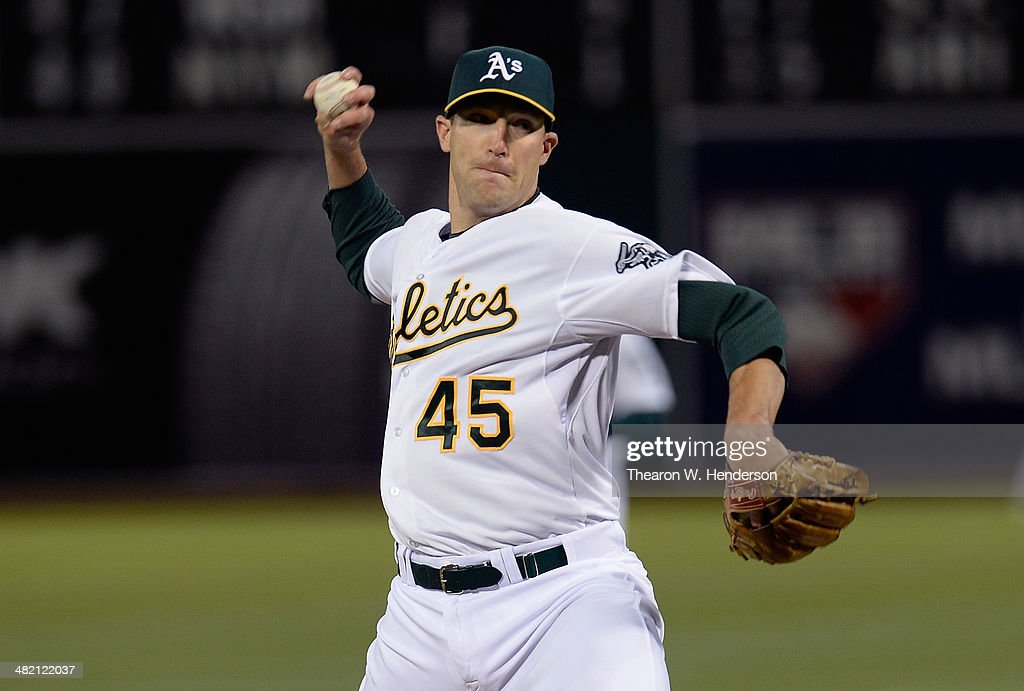 Jim Johnson #45 of the Oakland Athletics pitches against the Cleveland Indians during the ninth inning at O.co Coliseum on April 2, 2014 in Oakland, California.