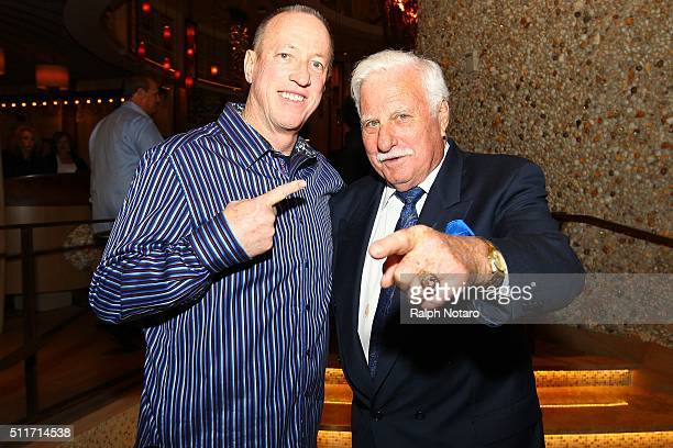 Jim Kelly and Howard Schnellenberger pose for photos during the Jason Taylor Foundation Celebrity Golf Classic Kick Off Party at Kuro at Seminole...
