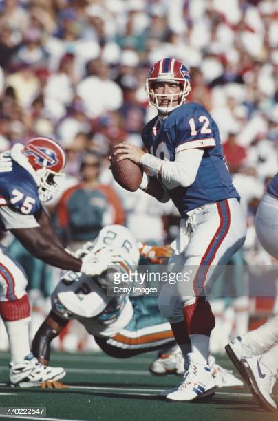 Jim Kelly Quarterback for the Buffalo Bills prepares to pass during the American Football Conference East game against the Miami Dolphins on 4...