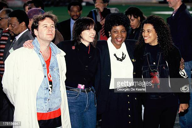 Jim Kerr, Chrissie Hynde, Winnie Madikizela-Mandela and Neneh Cherry attend backstage a concert held at Wembley Stadium to celebrate the release of...