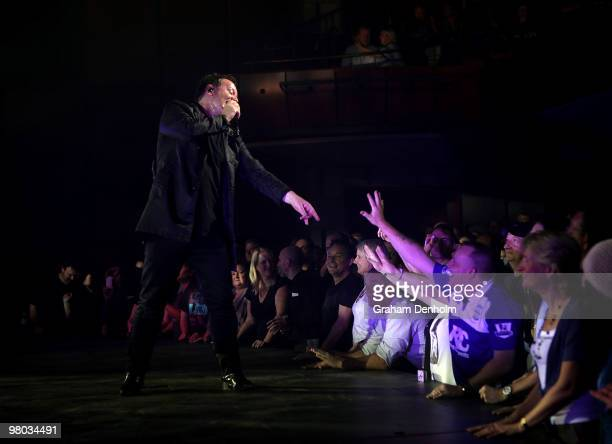 Jim Kerr of Simple Minds performs on stage during their concert at the Lyric Theatre Star City on March 25 2010 in Sydney Australia