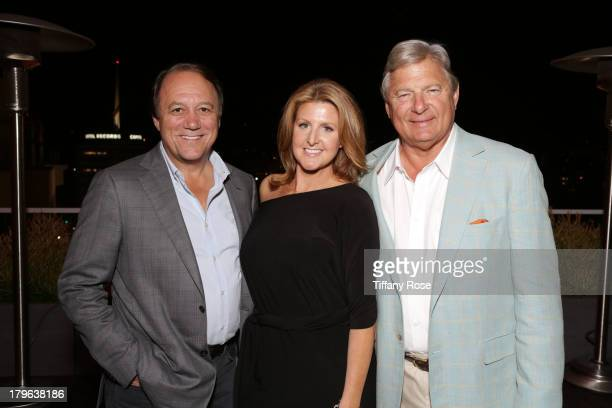 Jim Keyes Janelle Moore and Charles Ward attend the Auto Gallery Event at the residences at W Hollywood on September 5 2013 in Hollywood California