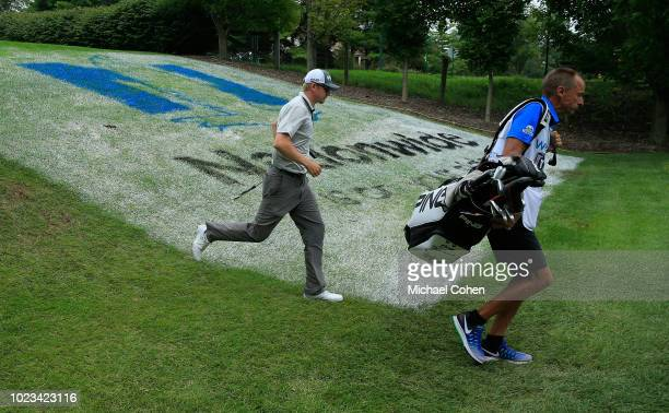 Jim Knous and his caddie run off the 17th hole tee box during the third round of the Nationwide Children's Hospital Championship held at The Ohio...