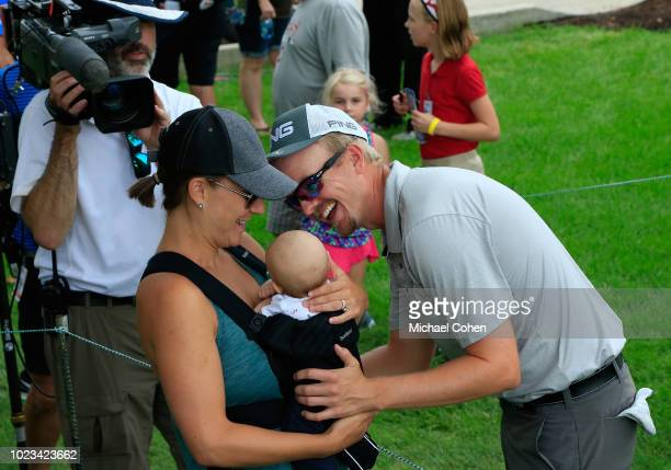 Jim Knous greets his wife Heidi Knous and son Brady Knous after finishing with the lead during the third round of the Nationwide Children's Hospital...