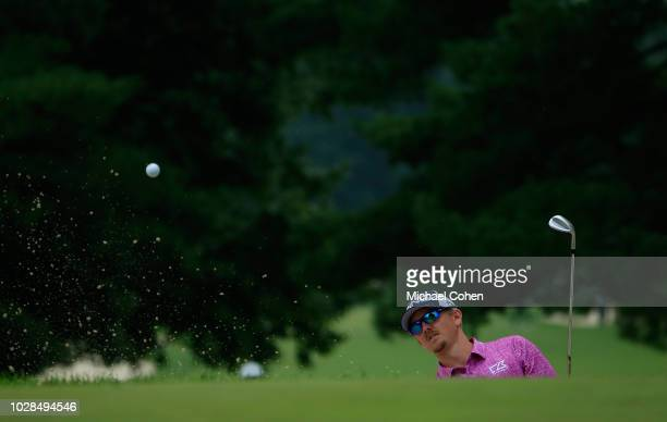 Jim Knous hits a shot from a bunker during the fourth and final round of the Nationwide Children's Hospital Championship held at The Ohio State...