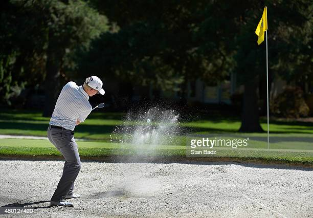 Jim Knous hits from a bunker on the ninth hole during the first round of the Webcom Tour Albertsons Boise Open presented by Kraft Nabisco at...