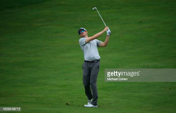 Jim Knous hits his second shot on the 18th hole during the third round of the Nationwide Children's Hospital Championship held at The Ohio State...