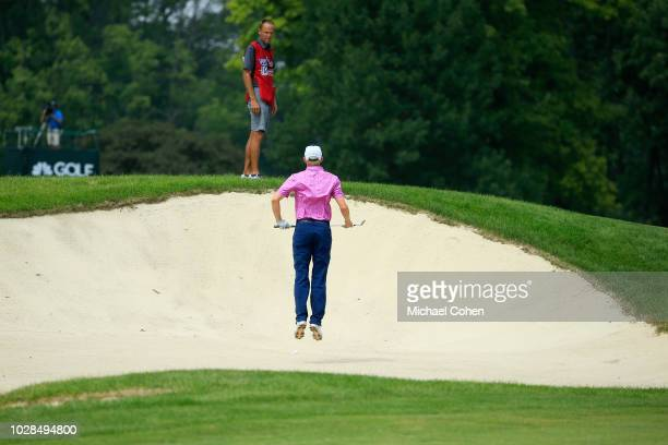 Jim Knous leaps in a bunker during the fourth and final round of the Nationwide Children's Hospital Championship held at The Ohio State University...