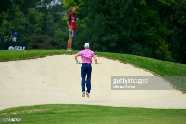 Jim Knous prepares to hit his second shot on the 10th hole from a bunker during the fourth and final round of the Nationwide Children's Hospital...