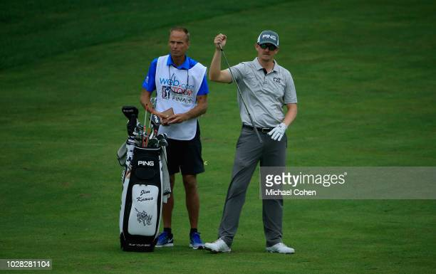 Jim Knous stands by his golf bag as he prepares to hit a shot during the third round of the Nationwide Children's Hospital Championship held at The...