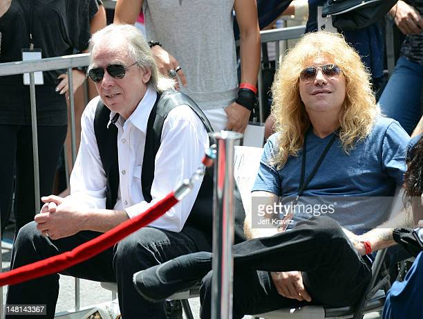 Jim Ladd and Steven Adler watch as Slash is honored with a star on the Hollywood Walk of Fame on July 10 2012 in Hollywood California