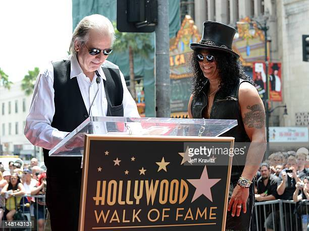 Jim Ladd speaks as Slash is honored with a star on the Hollywood Walk of Fame on July 10 2012 in Hollywood California