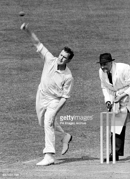 Jim Laker of Surrey bowling