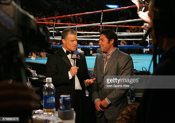 Jim Lampley Sportscaster and HBO Commentator talks with promoter and boxer Oscar de la Hoya prior to the fight between defending champion Bernard...