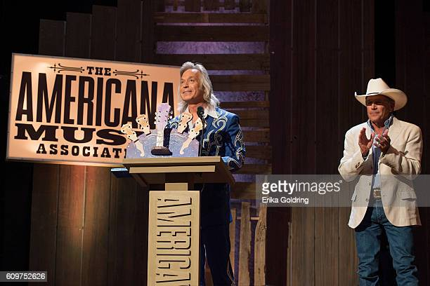 Jim Lauderdale receives the Wagon Master Award from George Strait at Ryman Auditorium on September 21 2016 in Nashville Tennessee