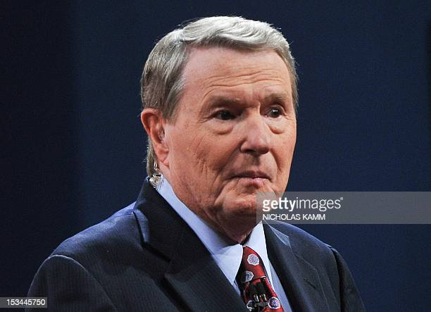 Jim Lehrer of the PBS Newshour speaks to the audience before moderating the first presidential debate between US President Barack Obama and...