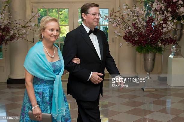 Jim Lentz III chief executive officer of the North America division of Toyota Motor Corp right and Barbara Lentz arrive at a state dinner hosted by...