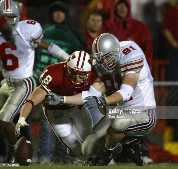 Jim Leonhard the Wisconsin Badgers fumbles the ball as Jason Bond State Buckeyes fights for the ball at Camp Randall Stadium in Madison Wisconsin