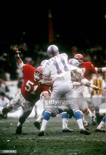 Jim Lynch of the Kansas City Chiefs pursues quarterback Pete Beathard of the Houston Oilers during an AFL football game at Kansas City Municipal...