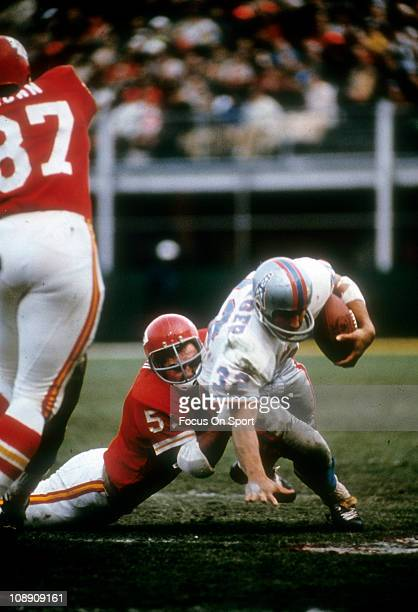 Jim Lynch of the Kansas City Chiefs tackles Hoyle Granger of the Houston Oilers during an AFL football game at Kansas City Municipal Stadium October...
