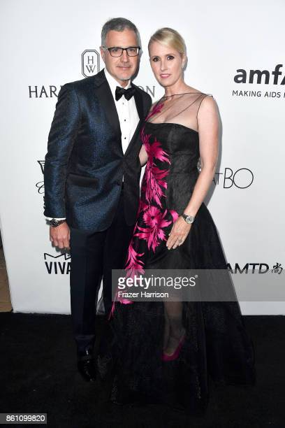 Jim Madden and Heather Madden attend the amfAR Gala at Ron Burkle's Green Acres Estate on October 13 2017 in Beverly Hills California