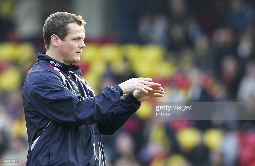 Jim Magilton manager of Ipswich Town watches his team warm-up prior to the FA Cup sponsored by E.ON 5th Round match between Watford and Ipswich Town at Vicarage Road on February 17, 2007 in Watford, England.