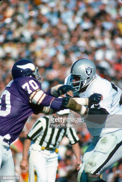 Jim Marshall of the Minnesota Vikings in action against Art Shell of the Oakland Raiders during Super Bowl XI on January 9 1977 at the Rose Bowl in...