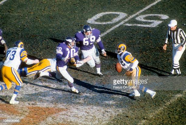 Jim Marshall of the Minnesota Vikings pursues quarterback James Harris of the Los Angeles Rams during the NFC/NFL Conference Championship football...