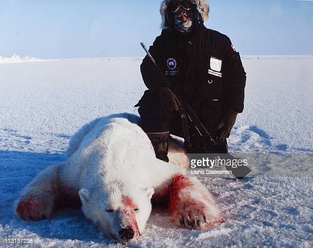 Jim Martell is pictured with a polar bear he shot in March 2009 on Banks Island in the Northwest Territories 'It's now in a taxidermy shop in...