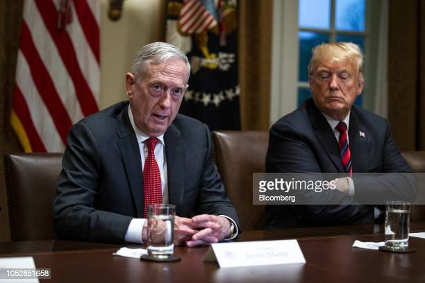 Jim Mattis US secretary of defense left speaks while seated next to US President Donald Trump right during a briefing with senior military leaders in...