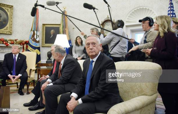 Jim Mattis US Secretary of Defense right sits during a meeting with US President Donald Trump left and congressional leadership in the Oval Office of...