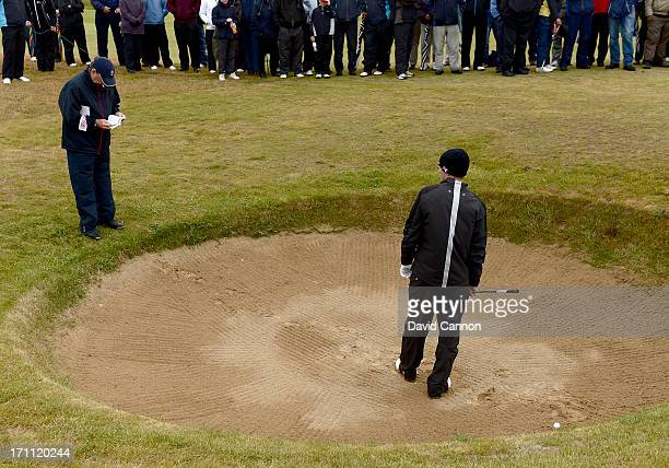 Jim McArthur the match referee checking the rules where Garrick Porteous of England played his second shot on the second hole where the ball...