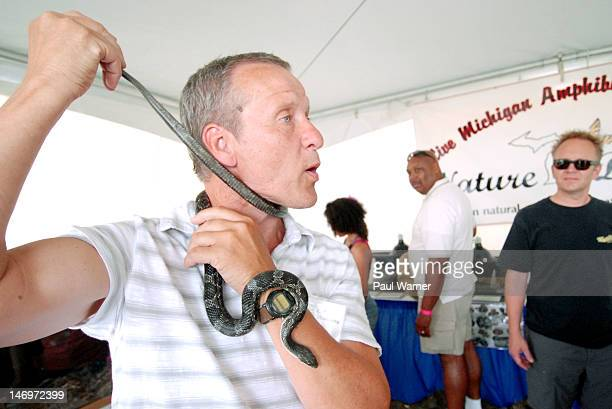 Jim McGrath of Nature Discovery a Michigan natural sciences education group handles a Michigan Black Rat Snake at the 2012 Detroit River Days...