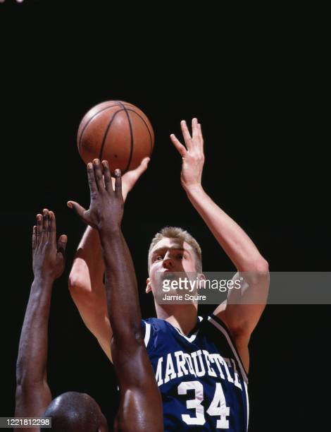 Jim McIlvaine, Center for the Marquette University Golden Eagles during the NCAA Great Midwest Conference college basketball game against the...