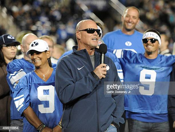 Jim McMahon former Brigham Young Cougars quarterback on field at halftime during the game against Utah State Aggies at LaVell Edwards Stadium on...