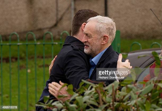 Jim McMahon MP hugs Labour Party Leader Jeremy Corbyn outside the Chadderton Town Hall after winning the Oldham West and Royton byelection on...