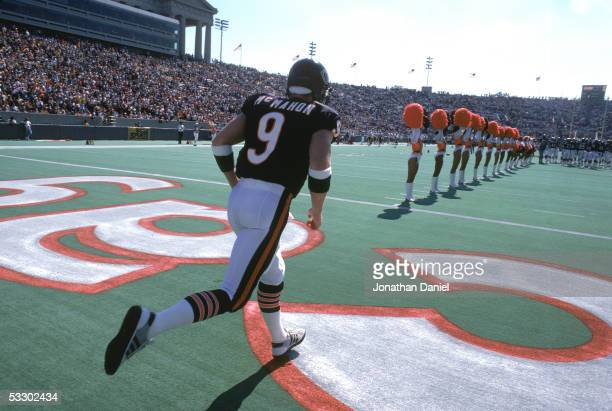 Jim McMahon of the Chicago Bears comes out for pregame introductions before the game against the Washington Redskins at Soldier Field on September 29...
