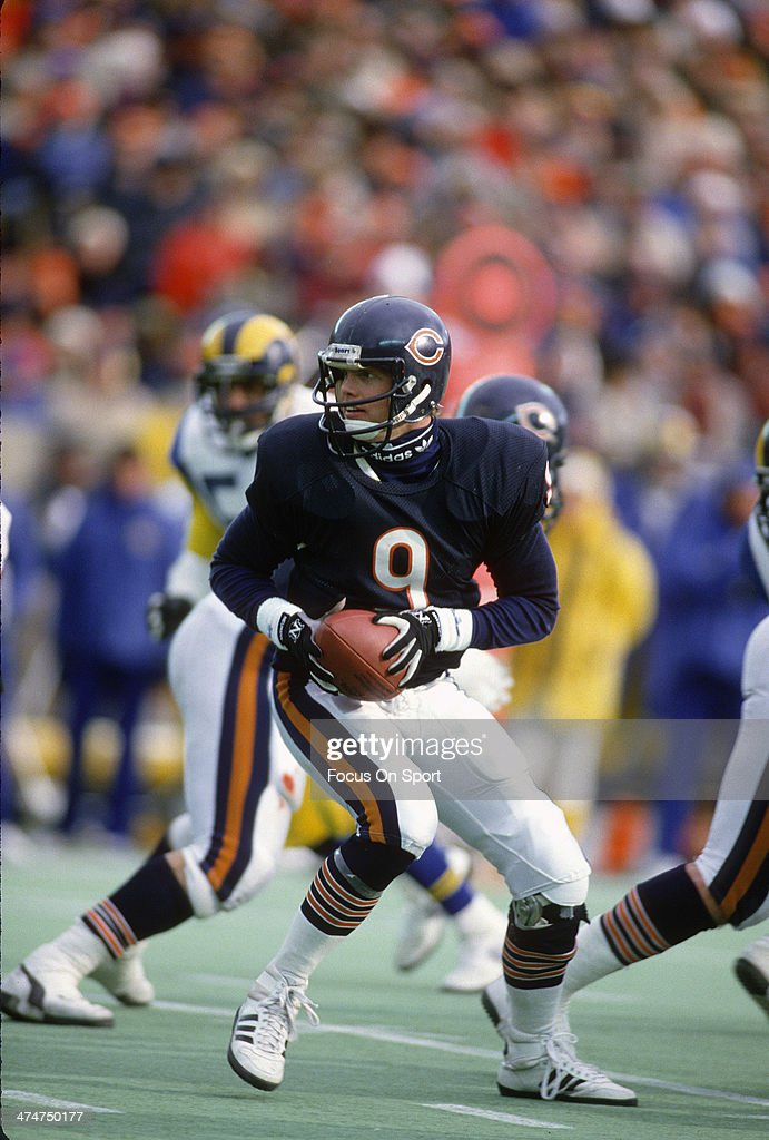 Jim McMahon of the Chicago Bears drops back to pass against the Los Angeles Rams during the NFC Conference Championship game January 12 1986 at...