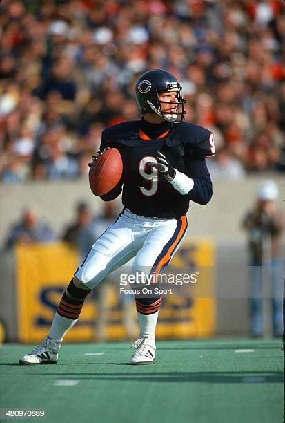 Jim McMahon of the Chicago Bears drops back to pass during an NFL Football game circa 1983 at Soldier Field in Chicago Illinois McMahon played for...