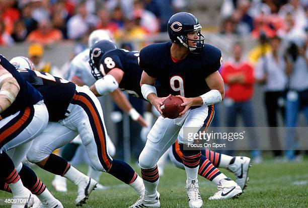Jim McMahon of the Chicago Bears in action against the Miami Dolphins during an NFL Football game September 4 1988 at Soldier Field in Chicago...