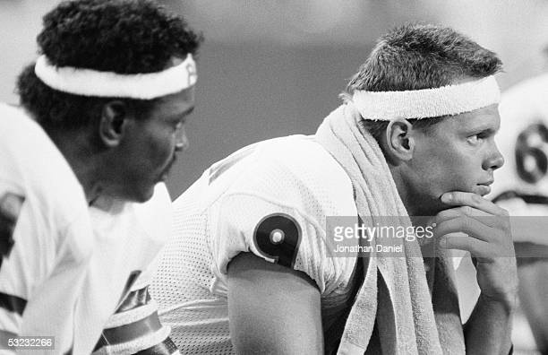 Jim McMahon of the Chicago Bears sits on the bench during the game against the Minnesota Vikings at the Metrodome on September 19 1985 in Minneapolis...