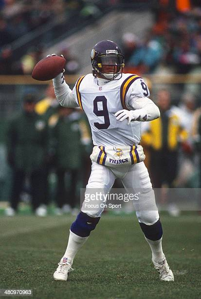 Jim McMahon of the Minnesota Vikings drops back to pass against the Green Bay Packers during an NFL Football game December 19 1993 at Milwaukee...