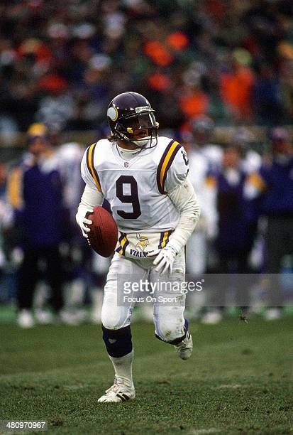 Jim McMahon of the Minnesota Vikings scrambles with the ball against the Green Bay Packers during an NFL Football game December 19 1993 at Milwaukee...