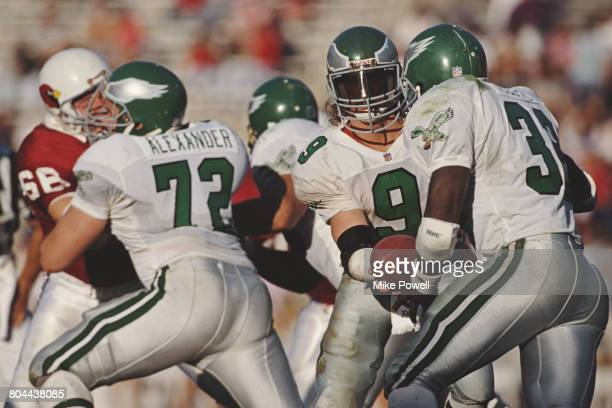 Jim McMahon Quarterback for the Philadelphia Eagles hands off the ball to Running Back James Joseph during the National Football Conference East game...