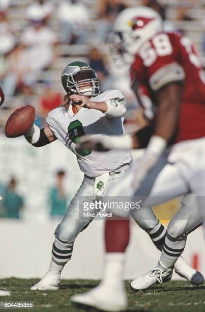 Jim McMahon Quarterback for the Philadelphia Eagles prepares to throw a pass during the National Football Conference East game against the Phoenix...