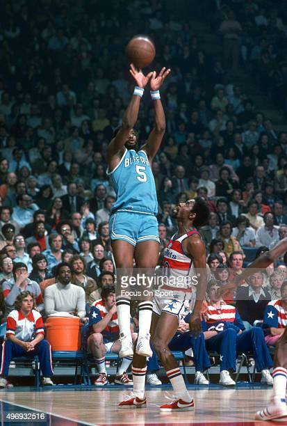 Jim McMillian of the Buffalo Braves shoots over Kevin Porter of the Washington Bullets during an NBA basketball game circa 1975 at the Capital Centre...