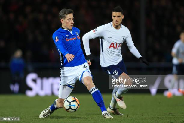Jim McNulty of Rochdale battles with Erik Lamela of Spurs during The Emirates FA Cup Fifth Round match between Rochdale AFC and Tottenham Hotspur at...