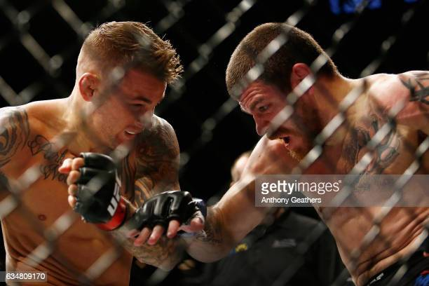 Jim Miller of United States fights against Dustin Poirier of United States in their lightweight bout during UFC 208 at the Barclays Center on...