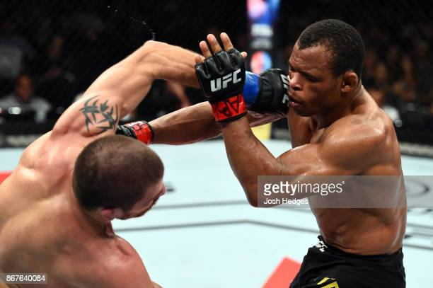 Jim Miller punches Francisco Trinaldo of Brazil in their lightweight bout during the UFC Fight Night event inside the Ibirapuera Gymnasium on October...