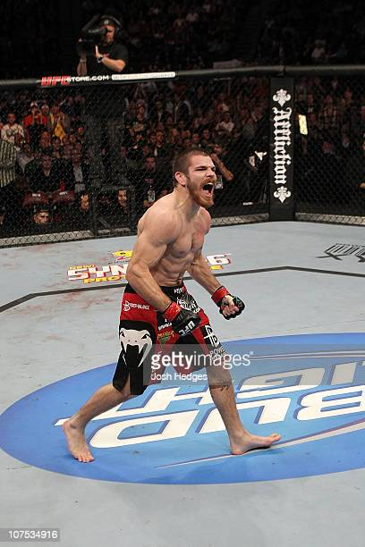 """Jim Miller reacts after he won his fight by submission against Charles Oliveira during their Lightweight """"Swing"""" bout during UFC 124 at the Centre..."""